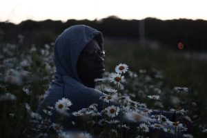 black man with flowers and shades